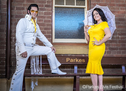 Elvis impersonator with woman in yellow dress