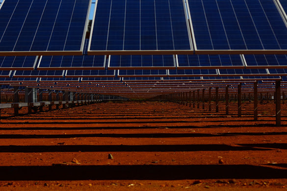 Close up of solar panels and red dirt at DeGrussa Mine