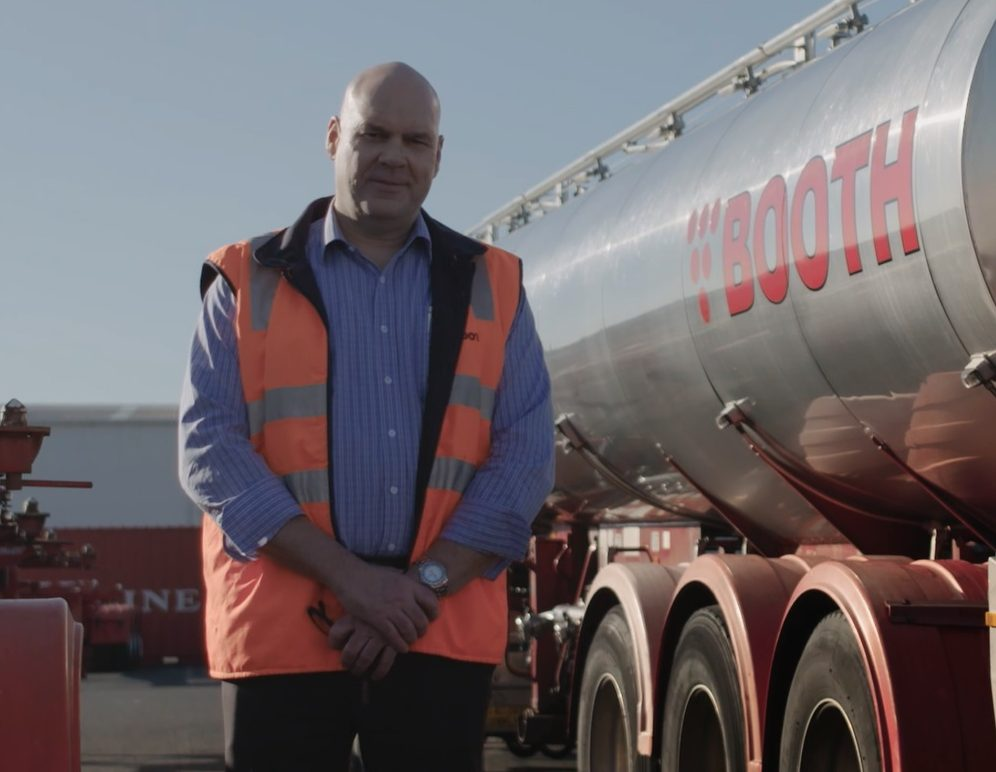 Mitchell Booth standing in front of his tanker