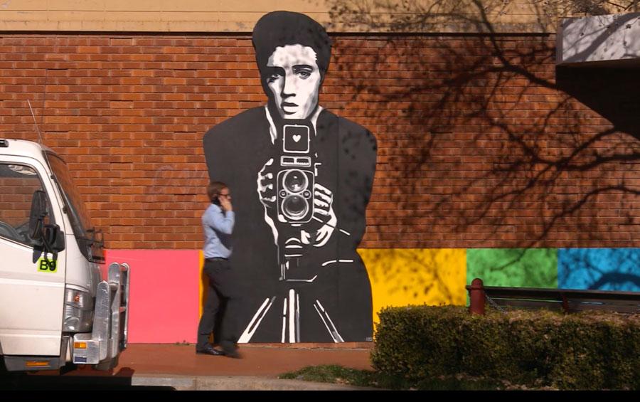 Elvis Muriel on a brick wall