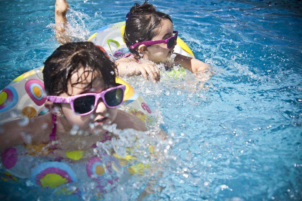 Children splashing in the swimming pool