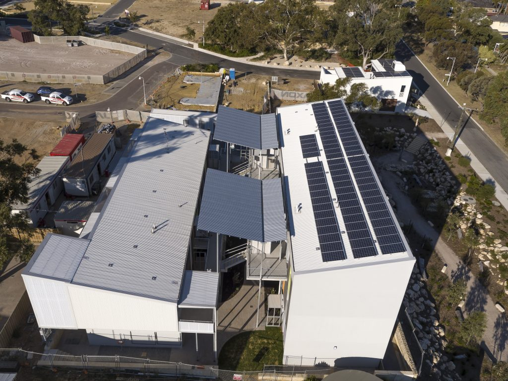 An aerial view of the development shows the rooftop solar panels
