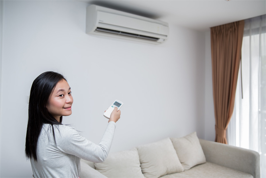 Girl using air conditioner