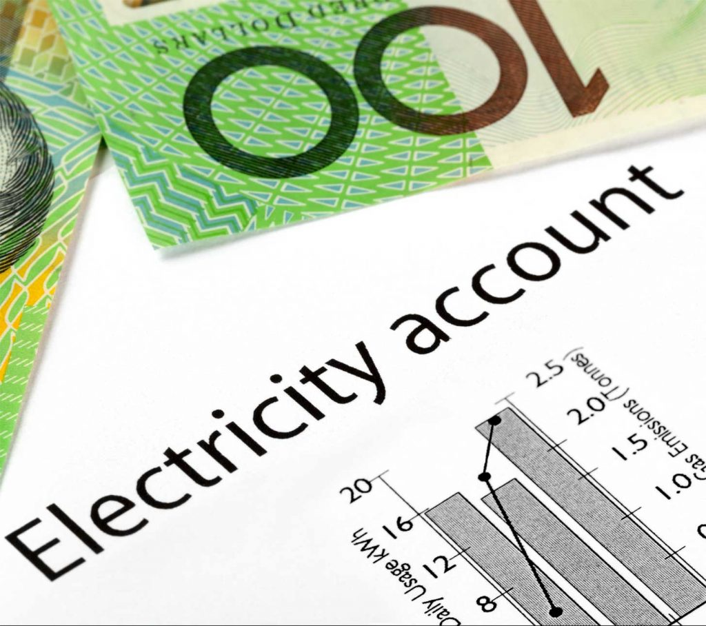 $100 dollar bill overlaying an electricity bill