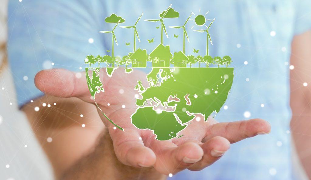 Businessman holding renewable energy sketch