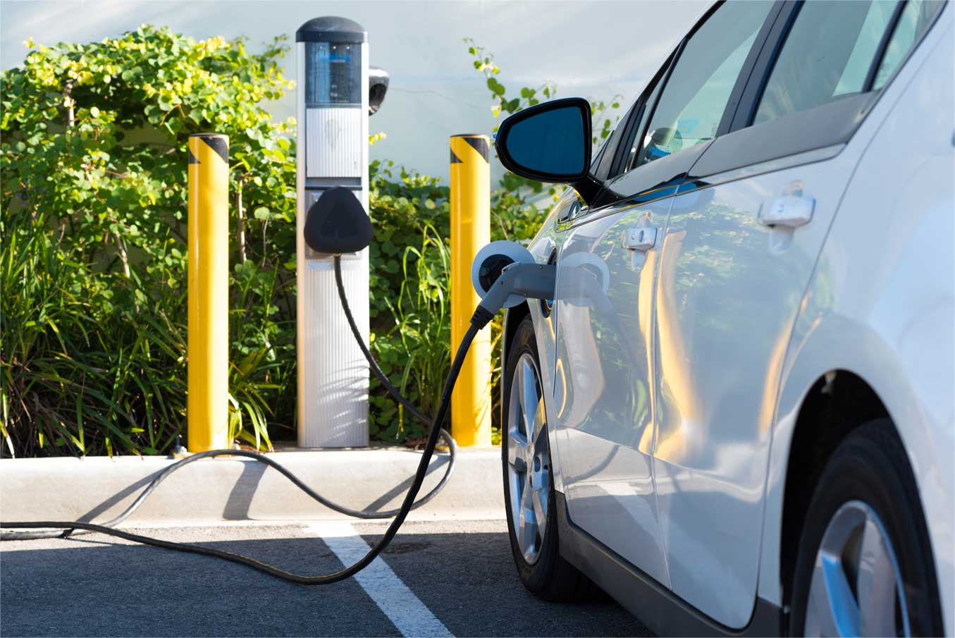Image - Electric vehicle charging at station