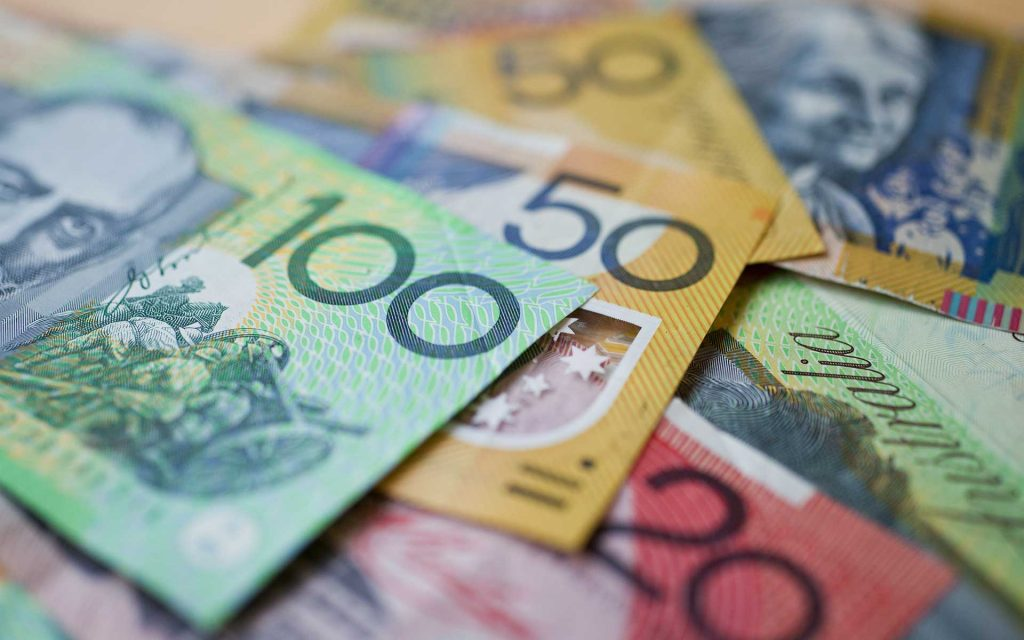 Australian dollars piled on top of eachother