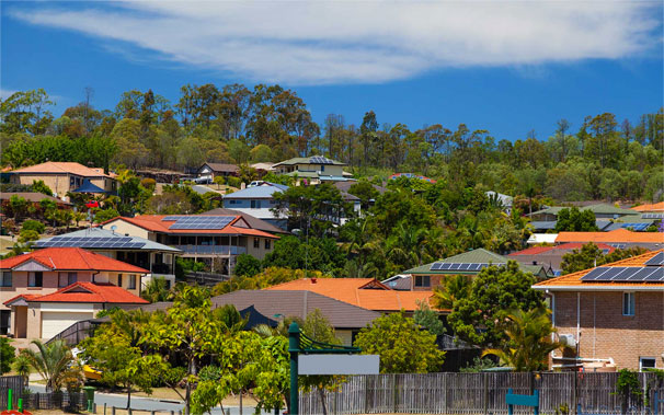 View of homes with solar panels on roof