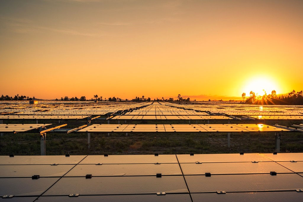 Image - Kidston solar farm with sun setting in the background