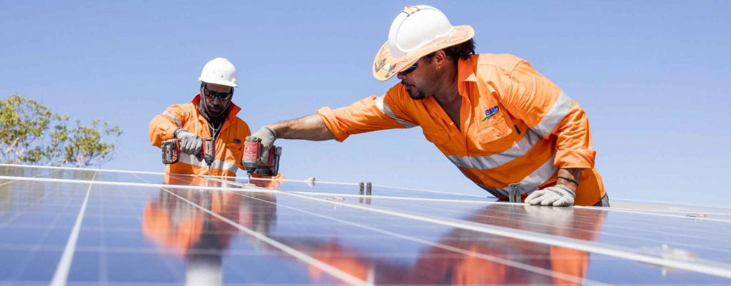 Two workers working on the Solar Setup NT project