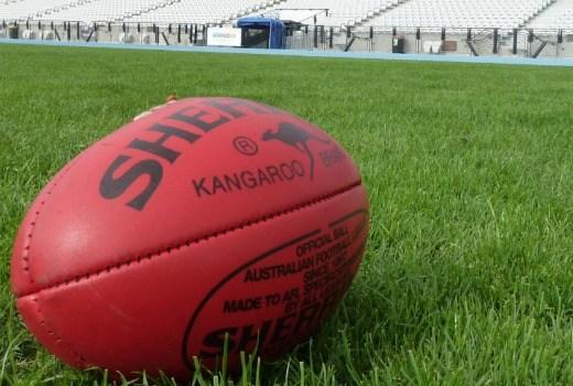 AFL football on grass