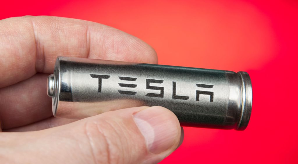 Hand holding a cell found in the TESLA battery