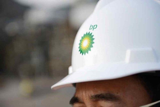 Man wearing safety headgear with BP logo