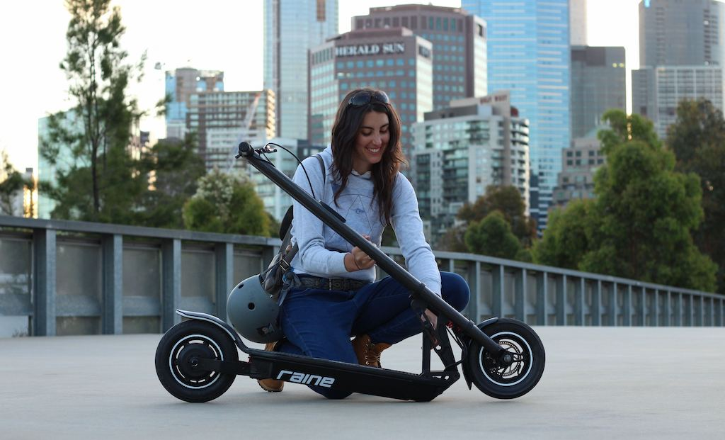 Woman with Raine electric scooter