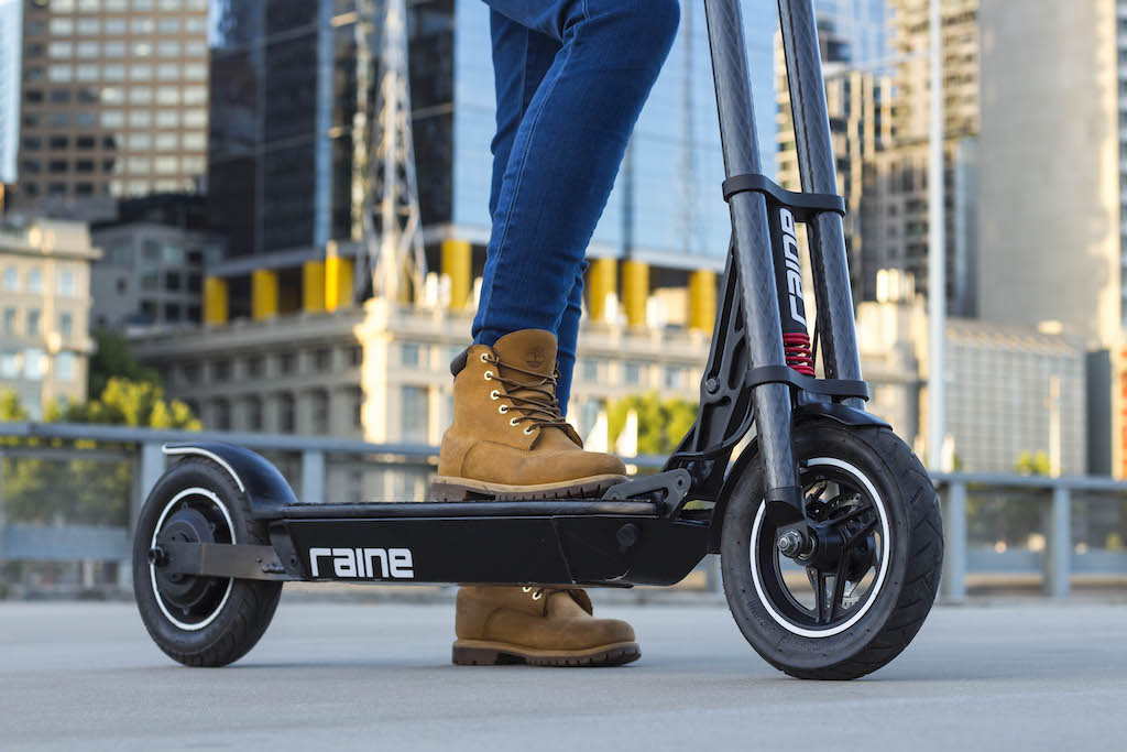 Woman on Raine electric scooter
