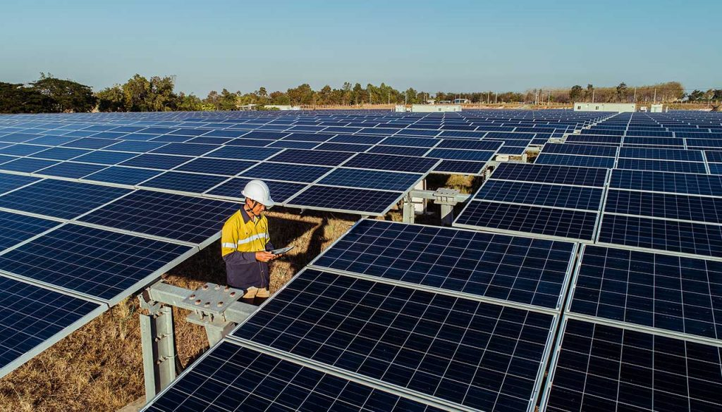 Worker at the large-scale solar farm at Emu Downs