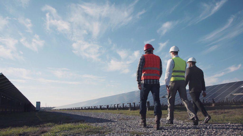 Energy trader staff walking through a newly constructed solar farm