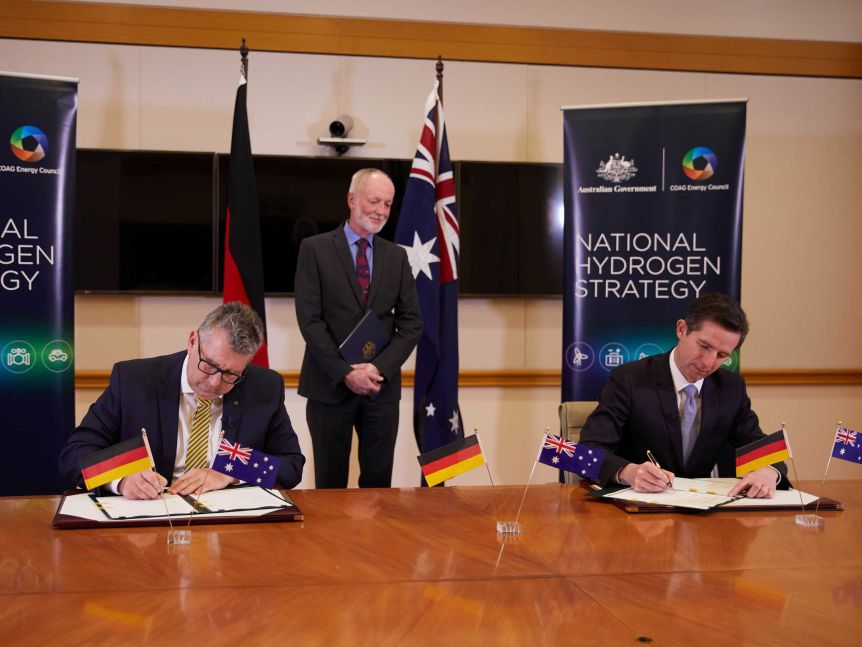 His Excellency Dr Thomas Fitschen, Ambassador of Germany, witnesses Australian ministers Birmingham and Pitt signing the declaration of intent